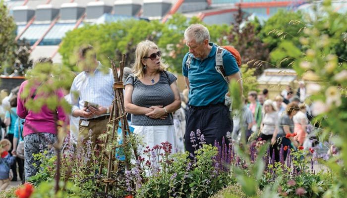 Visitors Enjoying the Show Gardens at Gardeners' World Live