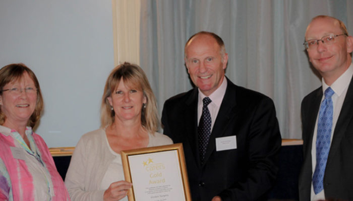 Hindon Surgery receiving their Gold Award at the Investors in Carers awards ceremony this year.